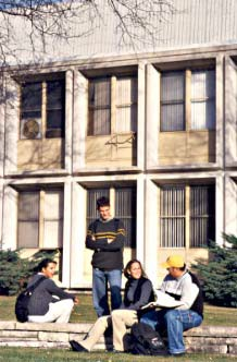 Students sitting in front of the Admin building